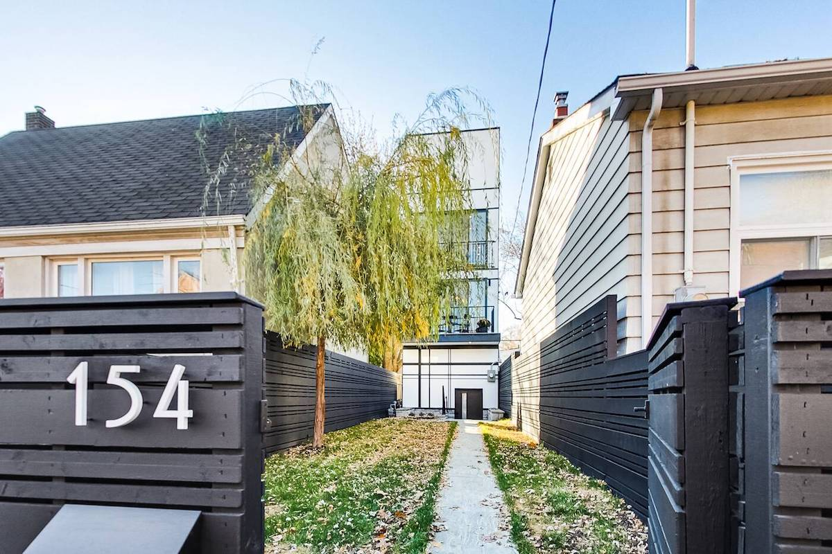 This skinny house in Toronto is back on the market for One million Less